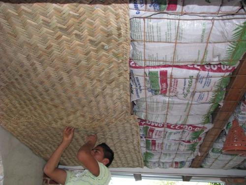 Installing mats over earthbag insulation