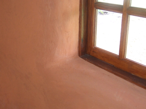 Curved Earthen Plaster around Window Openings