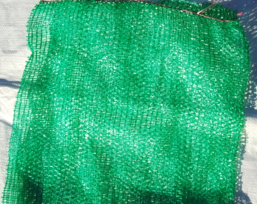 Close-up view of raschel mesh bags used for Hiperadobe.
