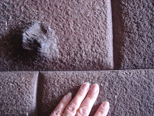 No spaces between stones indicates they may have been cast in place with geopolymer.
