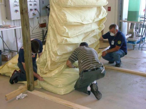 Filling connected bags to make an earthbag vault.