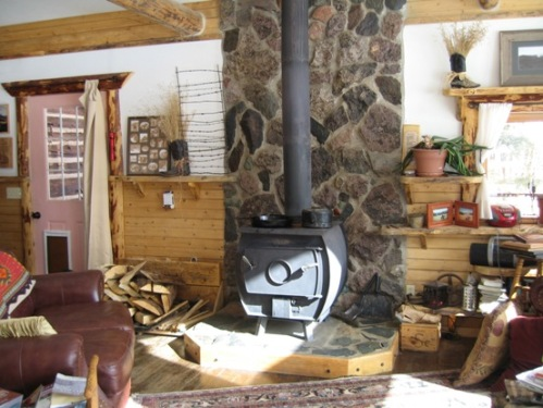 Wood stove with stone wall