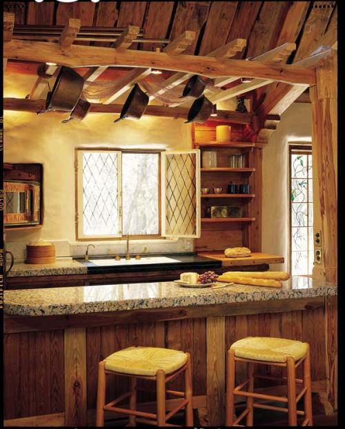 Gary Zuker sized and polished reclaimed granite for his kitchen countertop in his cob house near Austin, Texas.