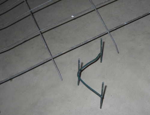 Wire mesh anchors can better secure barbed wire at corners