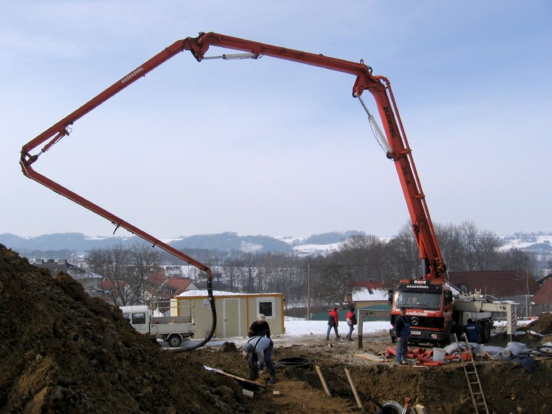 A concrete pump could be used to fill tubes on earthbag structures. (click to enlarge)