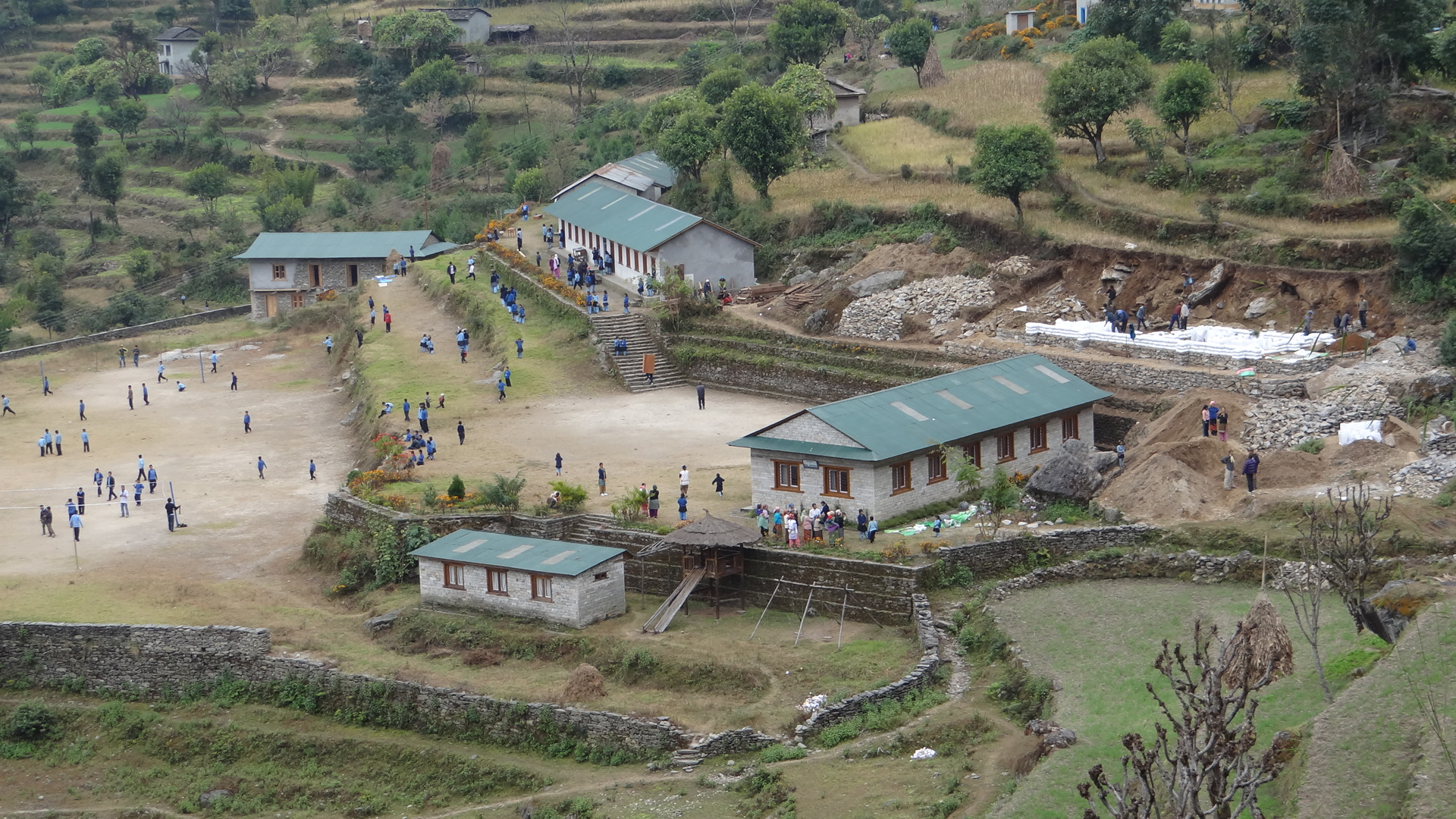 This school, an earthbag construction project, is the first of its kind in the region and (from what we know) just the 2nd time earthbags have been utilized in Nepal! (click to enlarge)
