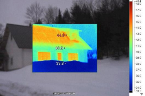 Infrared image showing heat loss in a home.