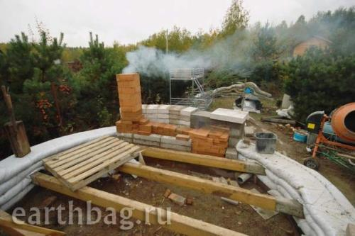 Earthbag house with mass heater fireplace at Earthbag.ru