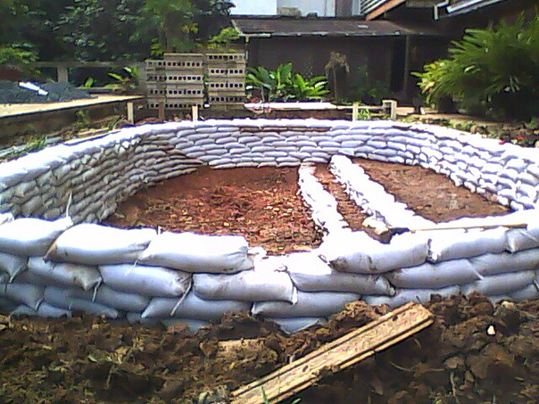 Sand bag fish pond natural building blog for Diy fish pond