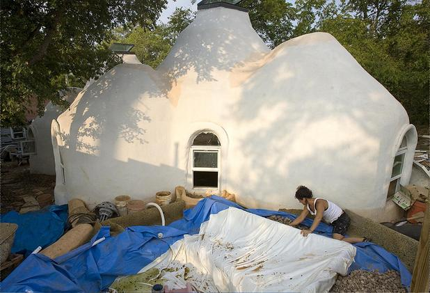 Thea Bryant and her children will soon move into a permitted earthbag house they built in Austin, Texas.