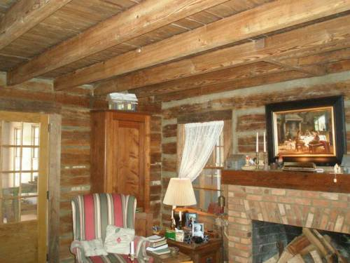 Rustic wood ceiling by Whole Log Lumber
