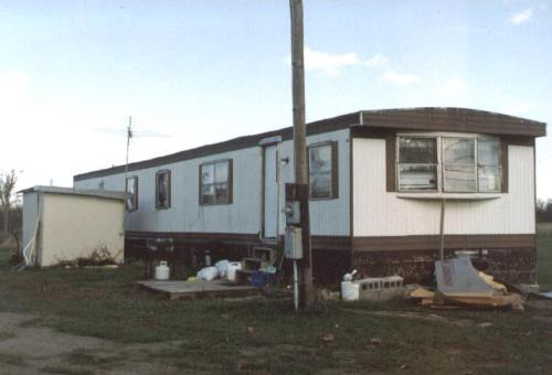 Trailer houses like this meet building codes even though they are unsafe and very poorly built.