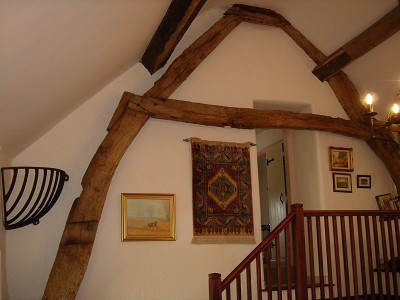 The Cruck Barn is the carefully restored remains of a late Medieval cottage or barn