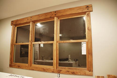 Rustic window trim with hand beveled pine boards, squared ends, honey ...