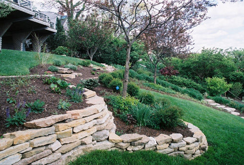 Delicieux Dry Stacked Stone Walls Create Level Planting Areas.