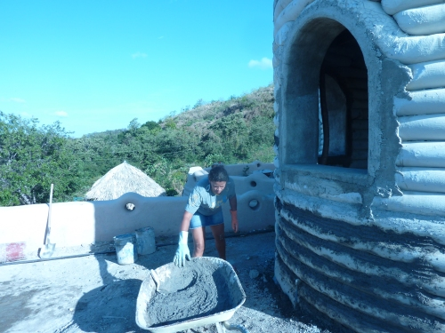Plastering an earthbag house with calcium carbide lime plaster in Nicaragua (click to enlarge)