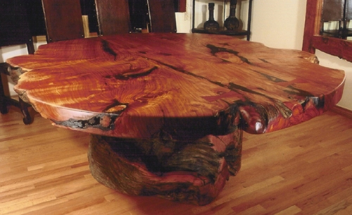 Rustic western dining room table with stump base