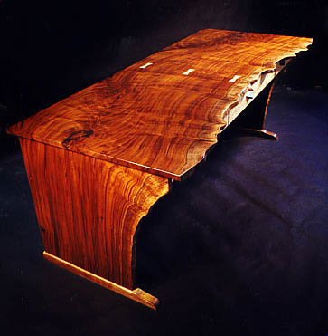 Slab claro walnut, natural edged executive desk. Although contemporary, it also has a unique rustic appeal.
