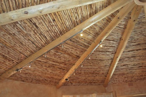 Roundhouse ceilng made with latillas and vigas