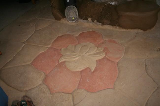 Lotus design in earthen floor